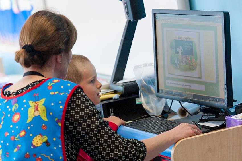 computer teacher and boy